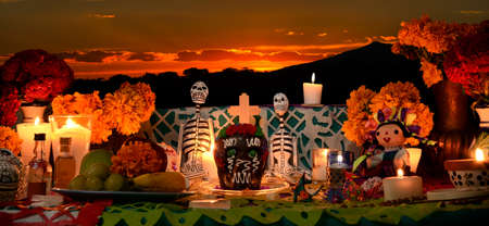 Day of the dead altar at sunset at dim candlelight