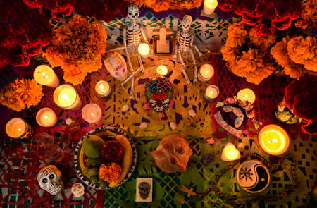 Day of the dead altar at night in dim candlelight Фото со стока