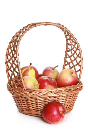 willow fruit basket: Wattled basket with delicious red apples on white background Stock Photo