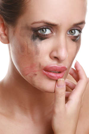 Portrait of the suppressed girl with the smeared cosmetics photo
