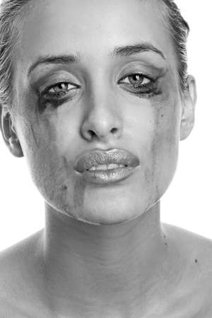 Close-up portrait of a crying woman with flowing make-up photo