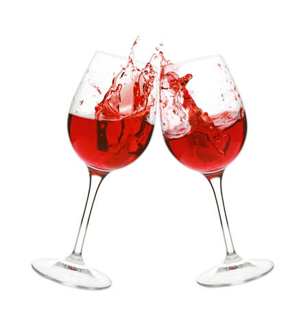 Red wine splash in two glasses, isolated on a white background  Stock Photo