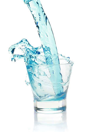 overflowing: Glass with splashing blue drink. isolated on a white background Stock Photo