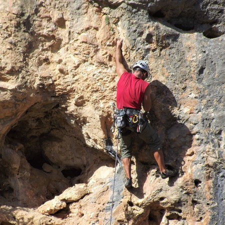 Climber on a rocky wall
