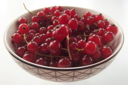 Gooseberry bowl on white background Stock Photo