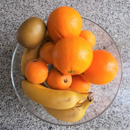 Top view of glass fruit bowl on granite stone