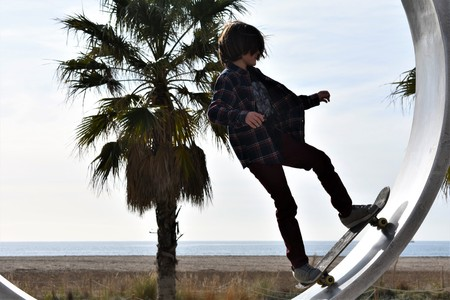 A teenager practices with a skateboard