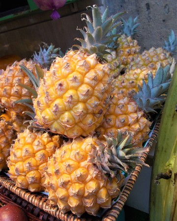 Basket of exposed pineapples for sale