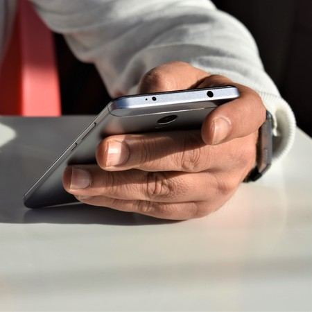 Male hand using a smartphone Stock Photo