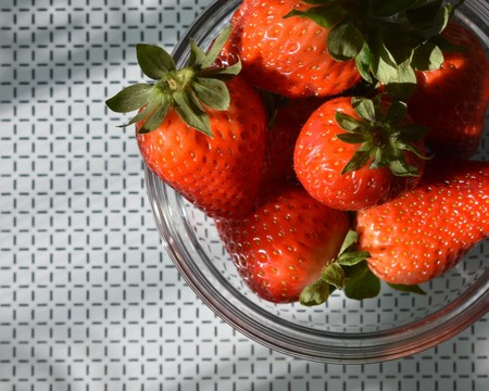 Close-up of a glass bowl with strawberries