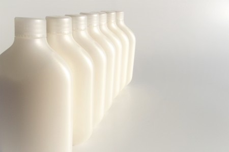 Image of a row of bottle-type plastic containers with space for text
