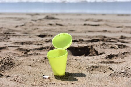 Beach ashtray embedded in the sand Stock Photo