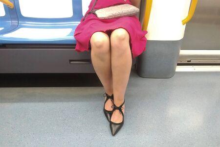 Passenger sitting during a subway ride