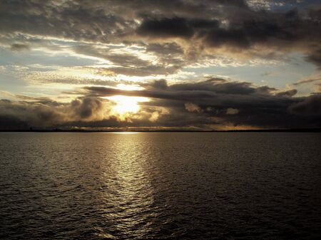 Stormy sky over a calm sea at sunset