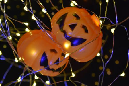 Halloween lights with two smiling pumpkins hanging on Stok Fotoğraf