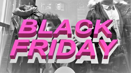 Black friday sale text in gray and pink on black and white photo of a clothing store Stock fotó