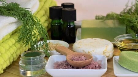 Top view of a spa ítems set of natural products: scented cream, salts, different soaps and herbal essential oils