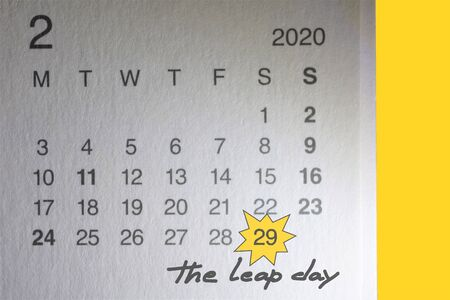 Calendar with mark on February 29, 2020 and leap day written by hand, with a yellow background