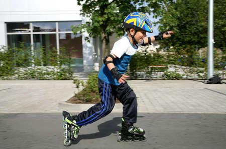Roller young boy - during training. 版權商用圖片 - 3680383