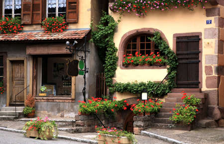 country house style: Typical colored houses in Alsace. Route des vines – France. Half-timbered wall.