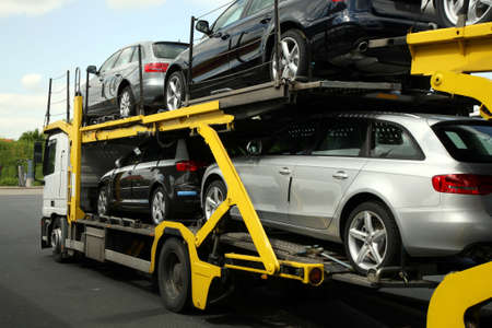Semitrailer transporting new cars. Export-import of goods.