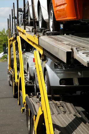 transporting: Semitrailer transporting new cars. Export-import of goods.