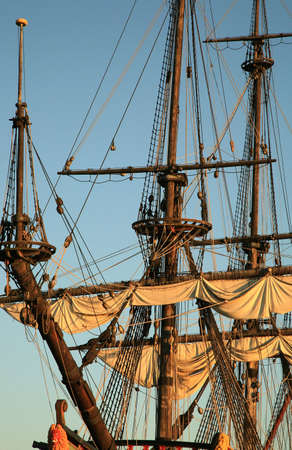 topsail: Details of sail � Batavia � historic galleon by sunset. Old ship. Flevoland, Netherlands.