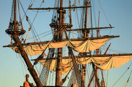 mast: Details of sail � Batavia � historic galleon by sunset. Old ship. Flevoland, Netherlands.