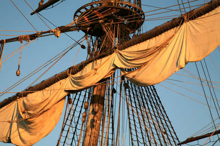 topsail: Details of sail – Batavia – historic galleon by sunset. Old ship. Flevoland, Netherlands.