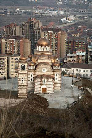 enclave: Orthodox Church and panorama of Kosovska Mitovica, Kosovo.