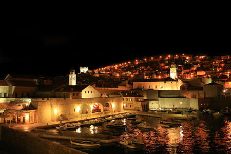 Stari Grad ( Old Town ) and famoust historic harbor in Dubrovnik – Croatia by night. Stock Photo - 3792072