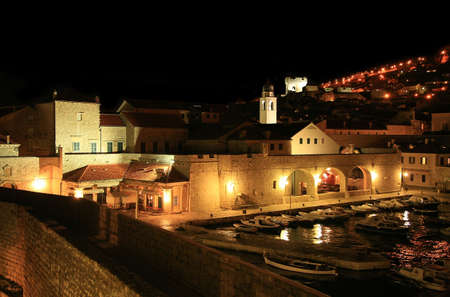 Stari Grad ( Old Town ) and famoust historic harbor in Dubrovnik – Croatia by night. Stock Photo
