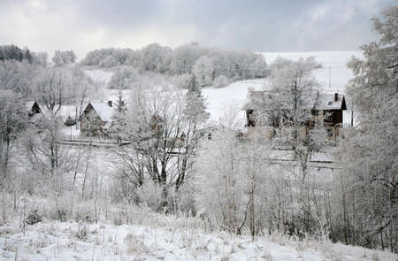 Winter in small village in Poland � Pasterka � Table Mountains � foggy day. photo