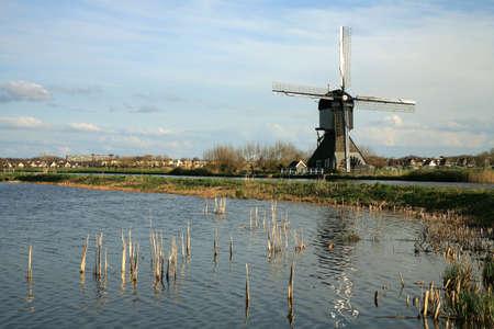 Traditional Dutch pumps - old windmills in Kinderdijk, Netherlands photo