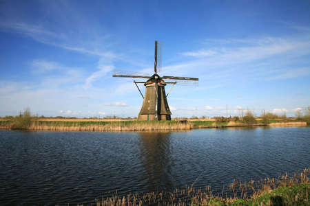 Traditional Dutch pumps - old windmills in Kinderdijk, Netherlands Stock Photo