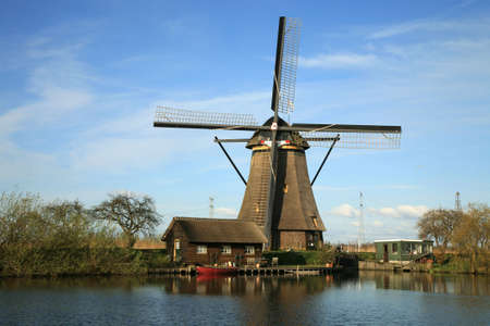 Traditional Dutch pumps - old windmills in Kinderdijk, Netherlands Stock Photo