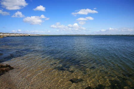 water  scenic: Delta Works - Dutch modern dam in Zeeland, Netherlands. Landscape. Stock Photo