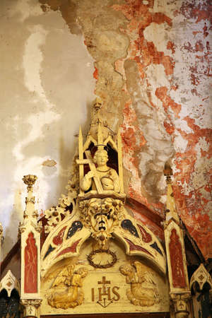 squalid: Interior of abandoned church, waste and debris on the floor. Demolished altar in historic church in small town in Croatia – Ston. Old, demolished church – inside. Editorial