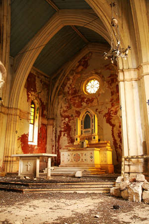 Interior of abandoned church, waste and debris on the floor. Demolished altar in historic church in small town in Croatia – Ston. Old, demolished church – inside. Editorial