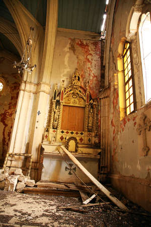 squalid: Interior of abandoned church, waste and debris on the floor. Demolished altar in historic church in small town in Croatia � Ston. Old, demolished church � inside. Stock Photo