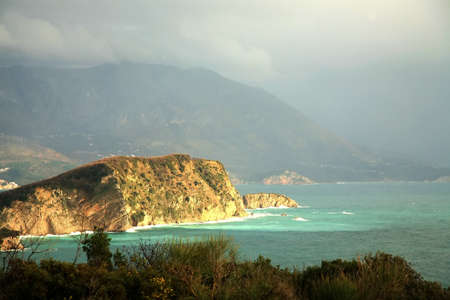 Magic moment after storm – view from hills near Budva – Montenegro. Rainbow above small bay. Stock Photo - 3946699