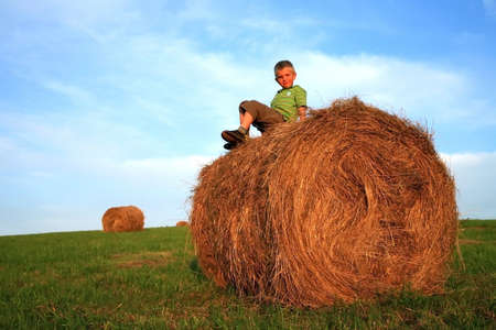 Little  boy on the meadow. Play on hay. Summer country – Pasterka, Poland Stock Photo - 3942151