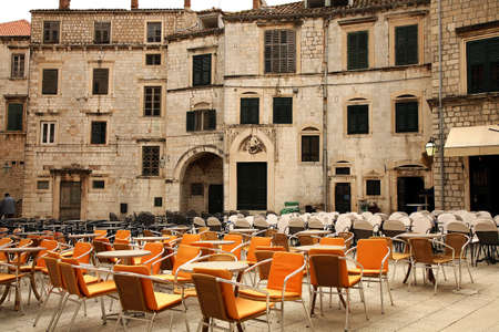 Square with restaurants  in Croatia � Dubrovnik after season. Famous city fortress on the Adriatic.  photo