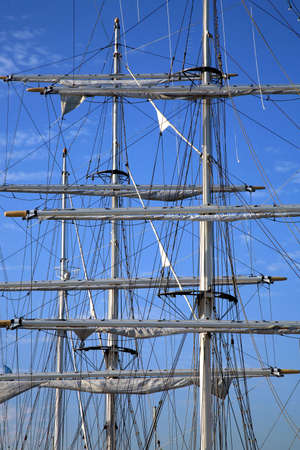 topsail: Details of modern sail by sunrise.  Modern ship � masts. Sailing.