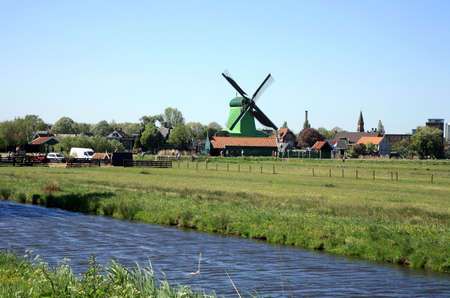 Famous picturesque Zaanse Schans in Netherlands. Group of historic old windmills .  Stock Photo - 4525616
