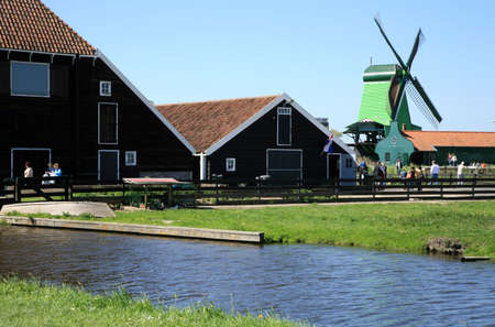 Famous picturesque Zaanse Schans in Netherlands. Group of historic old windmills . Stock Photo - 4525618