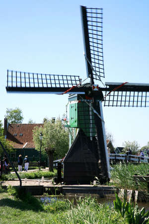 Famous picturesque Zaanse Schans in Netherlands. Group of historic old windmills .  Stock Photo - 4525646