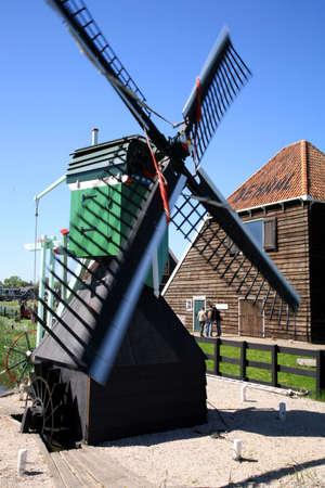 zaan: Famous picturesque Zaanse Schans in Netherlands. Group of historic old windmills .
