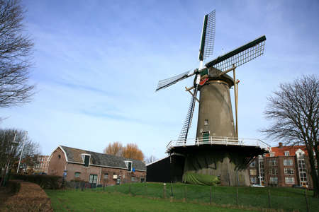 traditional windmill: Old , traditional windmill in The Hague – Netherlands. Stock Photo