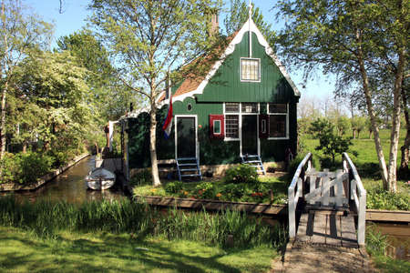 zaan: Famous picturesque Zaanse Schans in Netherlands. Dutch typical small house. Stock Photo